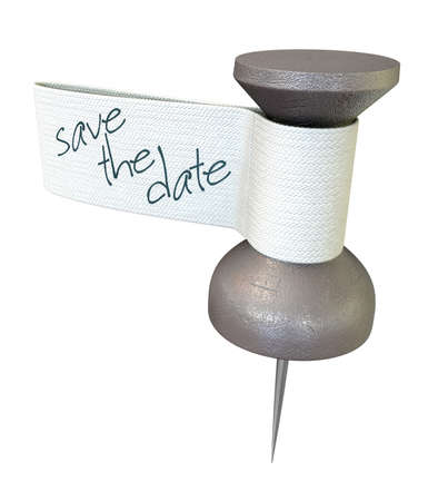 tagged: A metal thumbtack with a material tag and the words save the date written on it