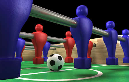 foosball: A foosball table at ground level with a soccer ball being competed for by a blue and red team ready to kick off a soccer match