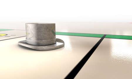 monopolio: Un primer plano de un icono de la matriz de metal fundido sombrero en un tablero de juego
