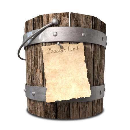 handle: A vintage wooden bucket with metal ring supports and a handle and a aged paper attached to the front that reads bucket list on an isolated background Stock Photo