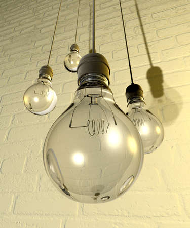 white washed: Four regular unlit light bulb fitted into light fittings hanging from chords on a white washed brick wall Stock Photo