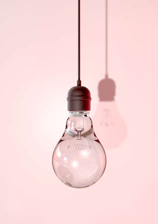 light fitting: A regular unlit light bulb fitted into a light fitting hanging from a chord on an isolated background