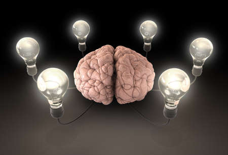 originality: A regular brain encircled by six cords  attached to illuminated lightbulbs on a dark background