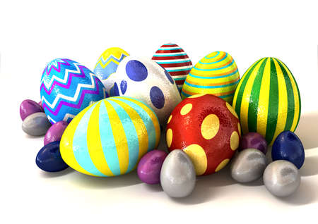 clusters: A collection of foil covered easter eggs huddled in a bunch on an isolated background Stock Photo