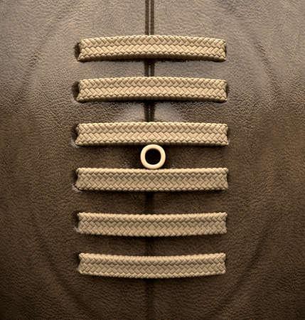 pelota rugby: Un primer plano de cuero viejo cl�sico bal�n de rugby con cordones y costuras Foto de archivo