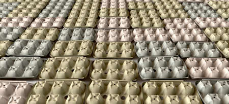 sound proof: A perspective view of a grid layout of typical egg boxes clad on a flat surface as used for sound proofing