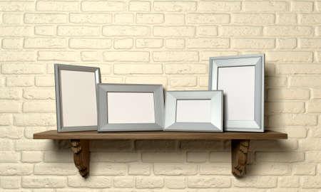 marco madera: Una vista delantera de un estante de madera normal mostrando 4 marcos en blanco de foto de metal en una pared de ladrillo amarillo Foto de archivo