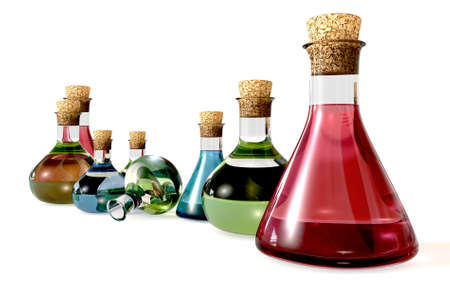 A collection of eight glass potion bottles with liquid in them in red green and blue on an isolated background Stock Photo