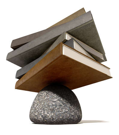 steadiness: A pile of leather books balancing on a rounded stone on an isolated background Stock Photo