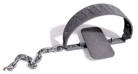 A metal animal trap that is closed attached to the ground with a metal chain on an isolated background Stock Photo - 17207558