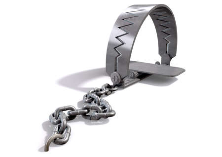 jaw: A metal animal trap that is closed attached to the ground with a metal chain on an isolated background Stock Photo