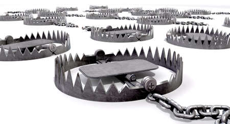 traps: A collection of randomly set out metal animal traps attached to the ground with metal chains on an isolated background Stock Photo