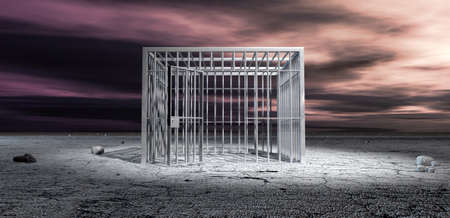 drab: A cubic shaped metal unlocked jail cell in the middle of a barren landscape under an ominous purple sky Stock Photo