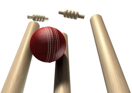 striking: A red leather cricket ball striking and unsettling wooden cricket wickets and bails on an isolated background Stock Photo
