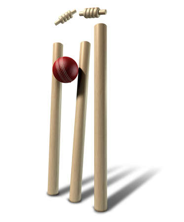 A red leather cricket ball striking and unsettling wooden cricket wickets and bails on an isolated background Stock Photo - 17948388