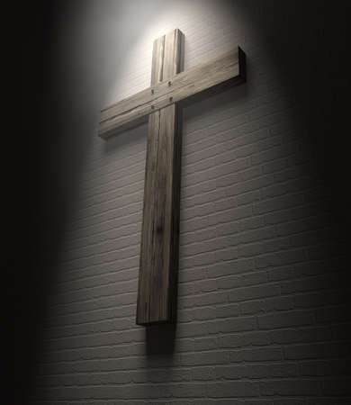 A regular wooden crucifix mounted on a white wall under a spotlight Stock Photo - 17948408