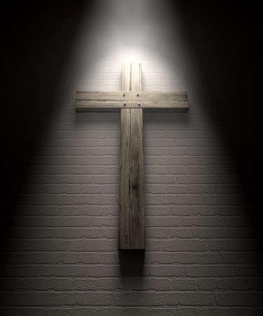 mounted: Een regelmatige houten kruisbeeld gemonteerd op een witte muur onder een spotlight Stockfoto