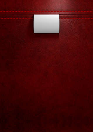 clothing tag: A white  woven clothing label sewn into seamed and stitched red leather Stock Photo