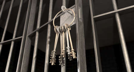 put away: A closeup of the lock of a  jail cell with iron bars and a bunch of key in the locking mechanism with the door open Stock Photo