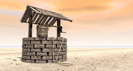 Un'acqua mattone bene con un tetto in legno e secchio attaccato ad una corda in un paesaggio arido pianeggiante con un cielo arancione