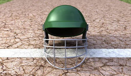 cricket helmet: A regular green plastic cricket helmet on a cracked cricket pitch with white markings