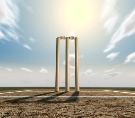 markings: A set of cricket wickets set up on a cracked cricket pitch with white markings on a blue sky background