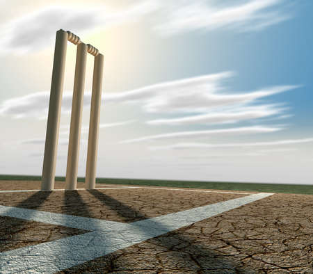cricket game: A set of cricket wickets set up on a cracked cricket pitch with white markings on a blue sky background