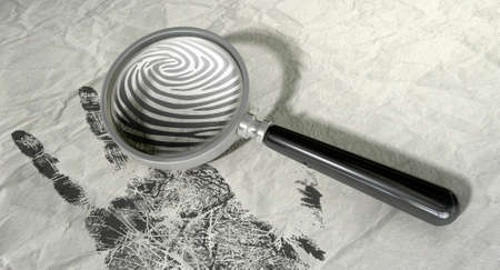 evidence: A regular magnifying glass magnifyng the fingerprint of a hand print on a crumpled paper   Stock Photo