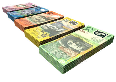 bundles: A uniform stack of bundled australian dollar notes on an isolated background Stock Photo