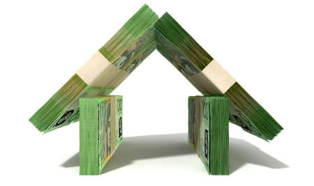 Stacks of one hundred australian dollar bank notes assembled in the shape of a house on an isolated background photo