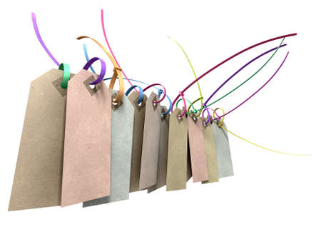 A collection of paper tags with colourful zip ties attached through their eyelets on an isolated background photo