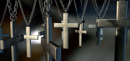 deliverance: A group of metal crucifixes hanging from chains on a dark background Stock Photo