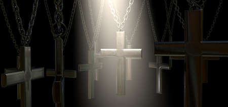 A group of metal crucifixes hanging from chains and a spiritual spotlight highlighting one in particular on a dark background Stock Photo - 19753212