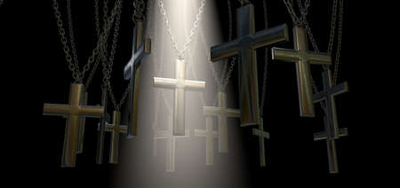 crucifixes: A group of metal crucifixes hanging from chains and a spiritual spotlight highlighting one in particular on a dark background