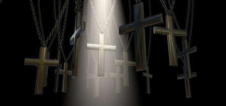 d�livrance: Un groupe de crucifix de m�tal suspendu � des cha�nes et un projecteur spirituel soulignant une en particulier sur un fond sombre Banque d'images