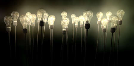 light up: A group of regular light bulbs attached to cables reaching skyward creating an eerie greenish foggy glow on a dark background