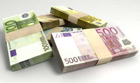 bundles: An assortment of euro note currency in scattered stacks on an isolated background Stock Photo