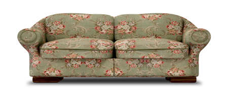 red sofa: An old vintage sofa with a green and red floral fabric on an isolated background