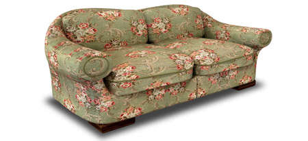 unpretentious: An old vintage sofa with a green and red floral fabric on an isolated background