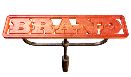 A metal cattle brand with the word brand as the marking area glowing red hot on an isolated background photo