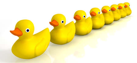 row: A row of organised and ready yellow rubber bath duck toys on an isolated background