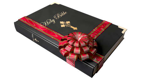 closed ribbon: A black leather bound bible with a red and green christmas bow and ribbon wrapped around it on an isolated background