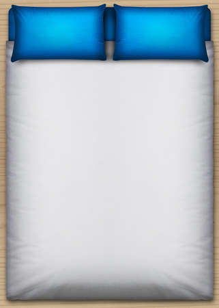 A direct top view from above a perfectly neat bed with a white duvet and two blue pillows on a wooden floor