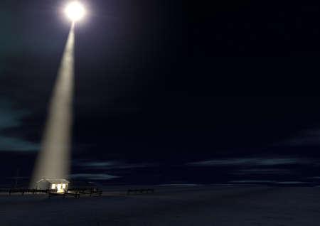 Een kerststal van christs geboorte in Bethlehem met de geïsoleerde vervallen stal wordt verlicht door een heldere ster op een donker blauwe hemel achtergrond