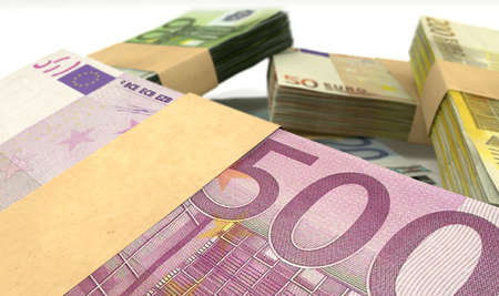 bundles: A scattered pile of euro bank notes bundled into value denominations on an isolated background Stock Photo
