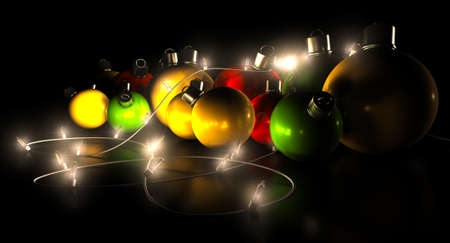 Regular green read and gold christmas baubles with a string of illuminated fairy lights draped over them on an isolated black background photo