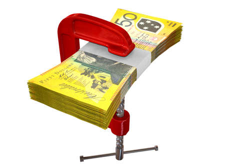 out of control: A red clamp clamping down on a bundle of fifty australian dollar bills on an isolated studio background Stock Photo