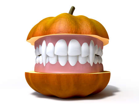 A humorous halloween concept of a pumpkin split in two with vampire false teeth sandwiched between the two halves on an isolated background