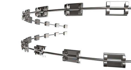 orthodontics: A set of assembled metal braces used for orthodontic teeth straightening on an isolated white background