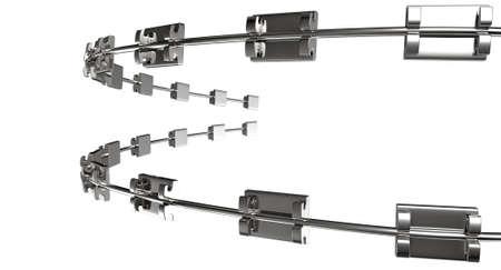 orthodontics: Un conjunto de aparatos met�licos ensamblados utilizados para los dientes de ortodoncia enderezan sobre un fondo blanco aislado Foto de archivo